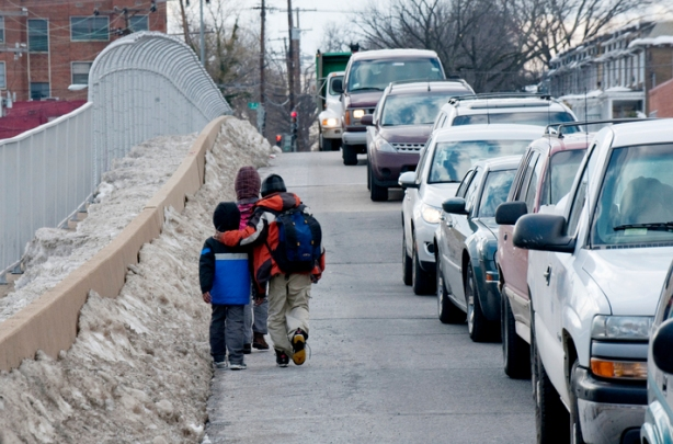 Children dangerously walk along a foot bridge in Northeast to go to and from school.